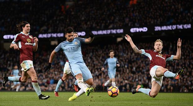 Manchester City's Argentinian striker Sergio Aguero (C) shoots but fils to score during the English Premier League football match between Manchester City and Burnley at the Etihad Stadium in Manchester, north west England, on January 2, 2017. / AFP / Oli SCARFF /