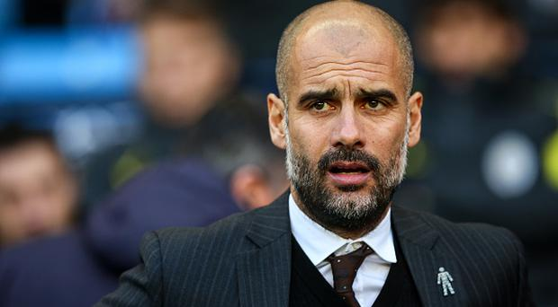 MANCHESTER, ENGLAND - JANUARY 02: Josep Guardiola manager / head coach of Manchester City during the Premier League match between Manchester City and Burnley at Etihad Stadium on January 2, 2017 in Manchester, England. (Photo by Robbie Jay Barratt - AMA/Getty Images)