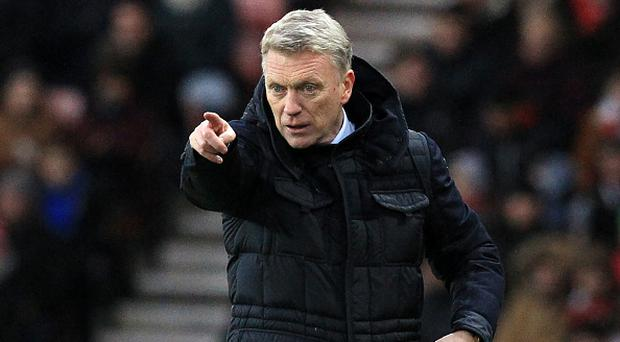 Sunderland's Scottish manager David Moyes gestures on the touchline during the English Premier League football match between Sunderland and Liverpool at the Stadium of Light in Sunderland, north-east England on January 2, 2017. / AFP / Lindsey PARNABY / RESTRICTED TO EDITORIAL USE. No use with unauthorized audio, video, data, fixture lists, club/league logos or 'live' services. Online in-match use limited to 75 images, no video emulation. No use in betting, games or single club/league/player publications. / (Photo credit should read LINDSEY PARNABY/AFP/Getty Images)