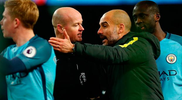 Guardiola remonstrates with referee Lee Mason. Photo: Getty
