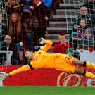 Simon Mignolet narrowly fails to prevent Jermain Defoe scoring from the penalty spot for Sunderland. Photo: Reuters