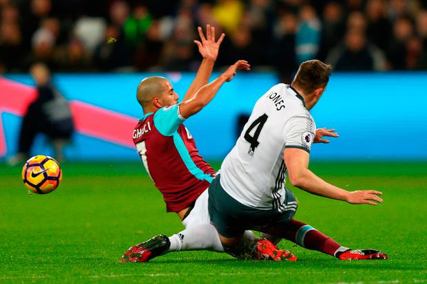 Sofiane Feghouli of West Ham United challenges Phil Jones of Manchester United leading to his sending off. Photo: Getty
