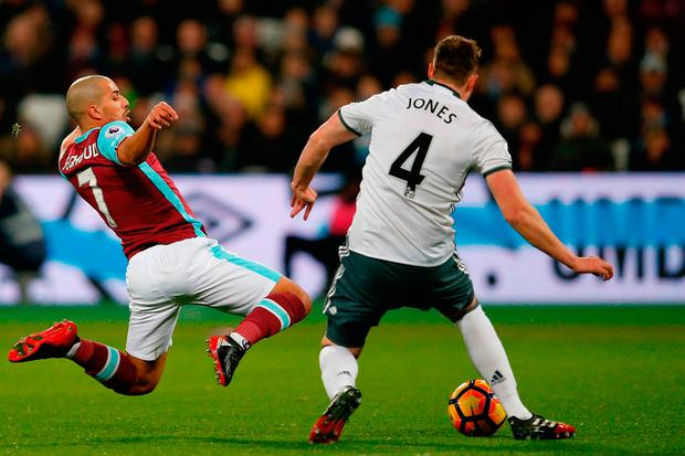 West Ham United's Sofiane Feghouli (L) leaps in to make a challenge on Manchester United's English defender Phil Jones and is subsequently sent off. Photo: Getty Images
