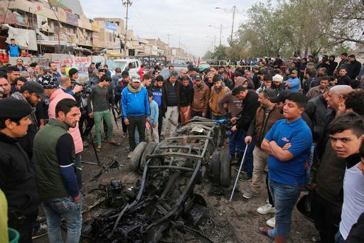 Citizens inspect the scene after the explosion. Photo: AP