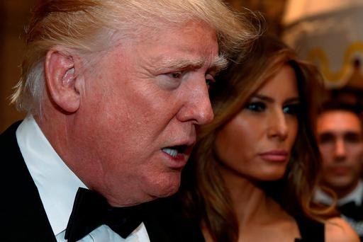 U.S. President-elect Donald Trump talks to reporters as he and his wife Melania Trump arrive for a New Year's Eve celebration with members and guests at the Mar-a-lago Club in Palm Beach, Florida, U.S. December 31, 2016. REUTERS/Jonathan Ernst/File Photo