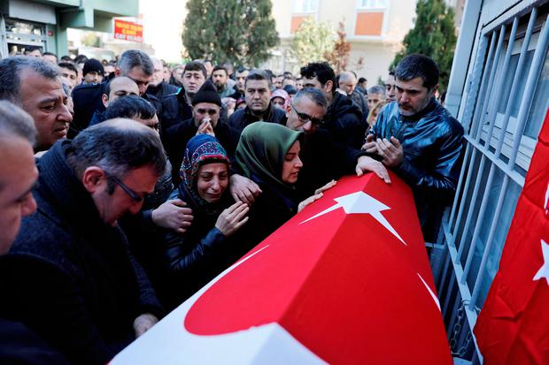 Relatives of Fatih Cakmak, a security guard and a victim of an attack by a gunman at Reina nightclub, react during his funeral in Istanbul, Turkey, January 2, 2017. REUTERS/Umit Bektas