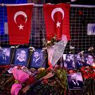Flowers and pictures of the victims are placed near the entrance of Reina nightclub, which was attacked by a gunman, in Istanbul, Turkey January 2, 2017. REUTERS/Yagiz Karahan