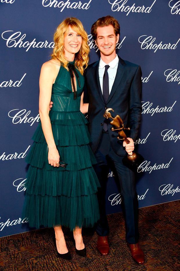 Actor Andrew Garfield poses with the Spotlight Award and actress Laura Dern during the 28th Annual Palm Springs International Film Festival Film Awards Gala at the Palm Springs Convention Center on January 2, 2017 in Palm Springs, California. (Photo by Michael Kovac/Getty Images for Palm Springs International Film Festival)