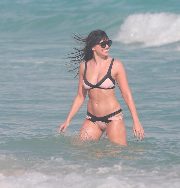 Daisy Lowe enjoys a beach day with friends in Miami Beach. Picture: KDNPIX / Splash News