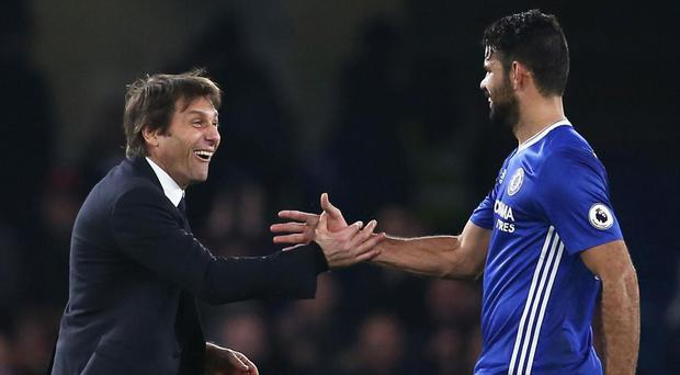 Chelsea manager Antonio Conte congratulates Diego Costa after their side's win over Stoke on New Year's Eve. Getty Images