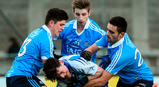 Dubs Stars' Stephen Smith is tackled by Dublin's Conor Mullally, Ross McGowan and Niall Scully during the New Year's Day clash. The CPA will focus minds on issues like the training-to-game ratio for all county players. Photo by David Maher/Sportsfile