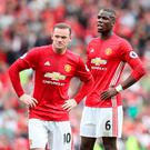 Manchester United's Wayne Rooney and Paul Pogba. Photo: PA