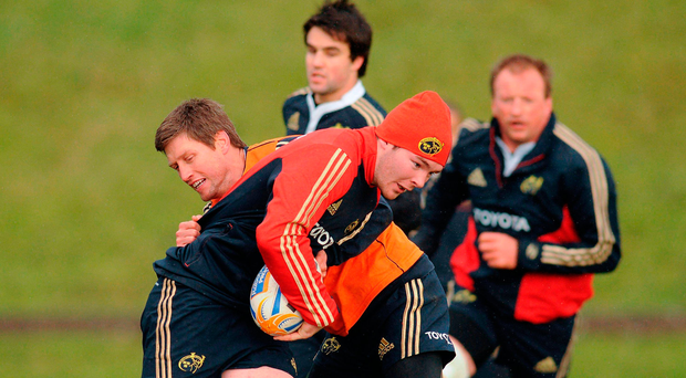Ronan O'Gara tackles Peter O'Mahony during their playing days together. The Racing 92 coach will be hoping his team stay as close to the Munster man during Saturday's European Cup clash. Picture credit: Diarmuid Greene / SPORTSFILE