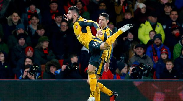 Arsenal's Olivier Giroud celebrates scoring their late equaliser
