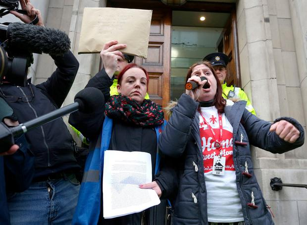 Carrie Hennessy and Niamh McDonald of the Irish Housing Network hold up a petition calling for action. Photo: Damien Eagers