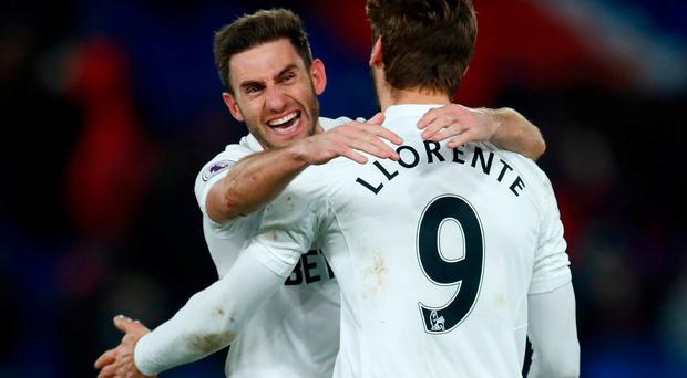 Swansea City's Fernando Llorente and Angel Rangel celebrate after the game