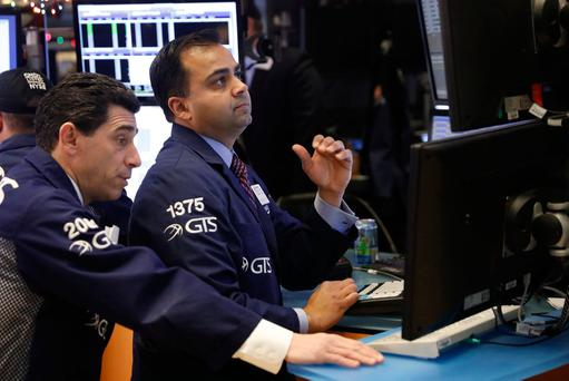 Traders work on the floor of the New York Stock Exchange (NYSE) shortly after the opening bell