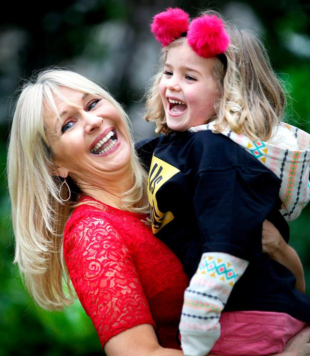 Miriam O'Callaghan with Molly Beasley (5) at the campaign launch. Photo: Gerry Mooney