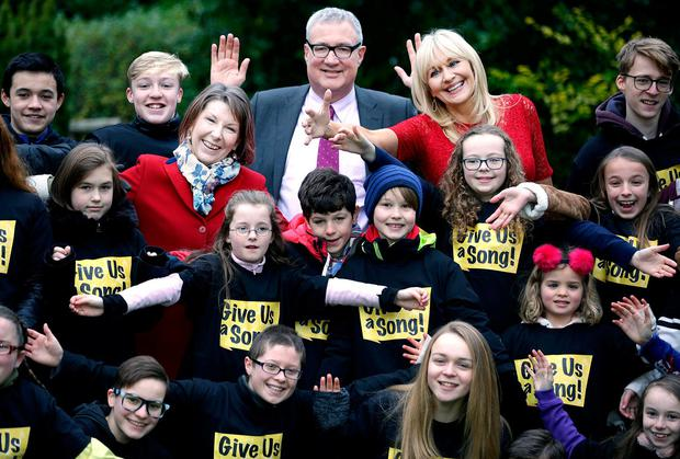 Aine with Prof John Crown, Miriam O'Callaghan and members of Piccolo Lasso Children's Choir. Photo: Gerry Mooney