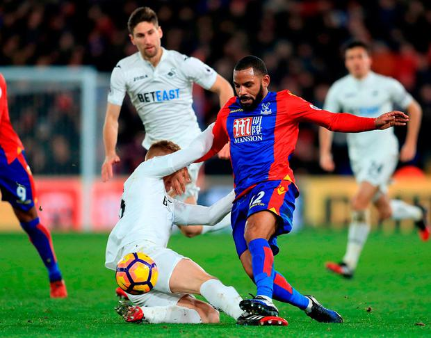 Swansea City's Jay Fulton and Crystal Palace's Jason Puncheon battle for the ball. Photo: Adam Davy/PA Wire