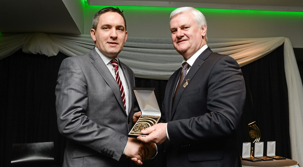 Aogán Ó Fearghail presenting Kevin Casey with the Best GAA related Radio Programme for