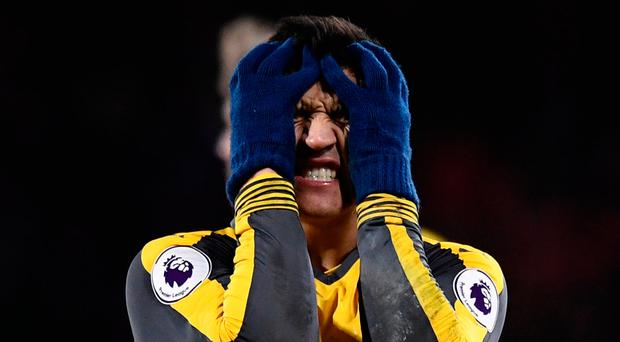 Arsenal's Alexis Sanchez looks dejected during the 3-3 draw with Bournemouth