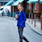 Asymmetric jacket, €25; printed crop top, €10; printed leggings, €20; knit runners, €20