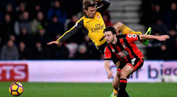 Bournemouth's Harry Arter in action with Arsenal's Nacho Monreal last night