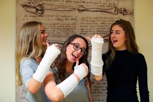 Pictured showing off their casts at the RCSI Open Day is Aoife Hynes, Sarah O'Keefe and Jane Tholey. Photo: Maxwells