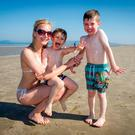 Kate Spila with son Adam and her nephew Daniel on Portmarnock Beach in Dublin. Photo: Douglas O'Connor