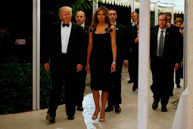 U.S. President-elect Donald Trump and his wife Melania Trump arrive for a New Year's Eve celebration with members and guests at the Mar-a-lago Club in Palm Beach