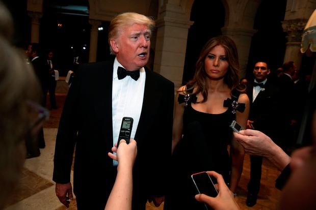 U.S. President-elect Donald Trump talks to reporters as he and his wife Melania Trump arrive for a New Year's Eve celebration with members and guests at the Mar-a-lago Club in Palm Beach, Florida