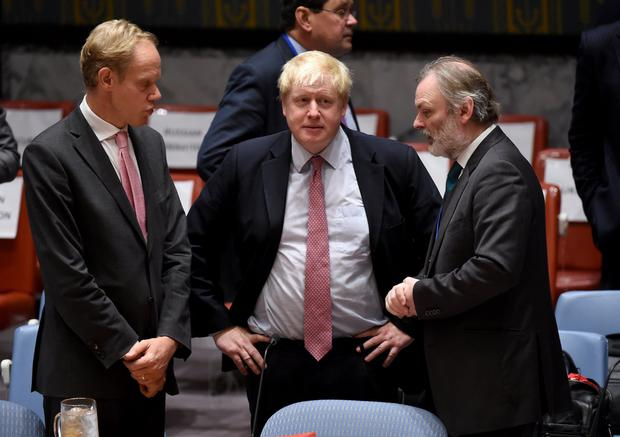 Boris Johnson, UK foreign secretary (C) speaks to Sir Tim Barrow (R) during a Security Council Meeting on the situation in Syria at the United Nations in New York. Photo: AFP/Getty Images