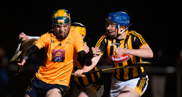 Paul O'De of DCU Dochas Eireann in action against Sean Buggy and John Donnelly of Kilkenny. Photo by Matt Browne/Sportsfile