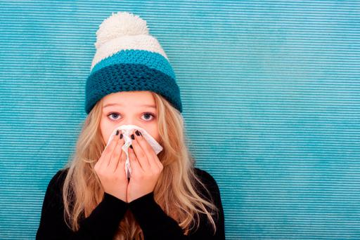 It is best to treat a cold or flu by resting, staying warm and keeping well hydrated. Stock Image