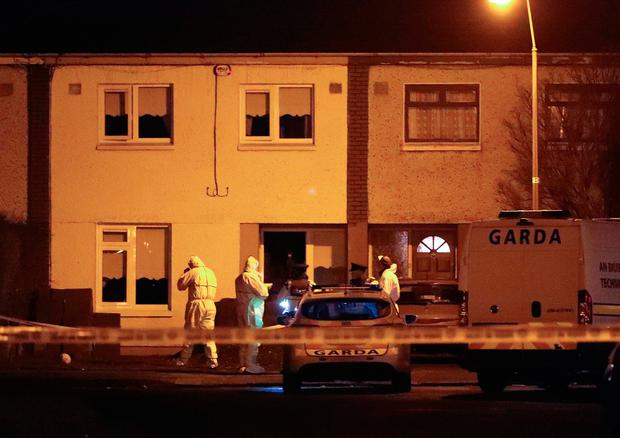 Gardaí at the scene of the fatal stabbing in Kilclare Crescent, Jobstown, last night. Photo: Collins
