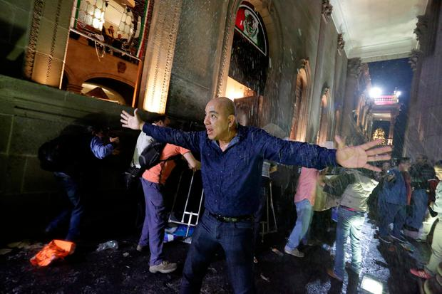 A man urges fellow demonstrators to calm down as they vandalise the Government Palace during a protest against the rising prices of gasoline enforced by the Mexican government, at the Macroplaza in Monterrey, Mexico, January 5, 2017. REUTERS/Daniel Becerril