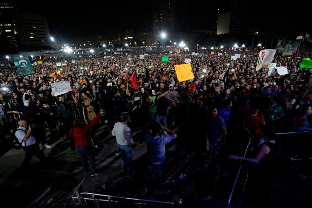 Demonstrators hold up placards during a protest against the rising prices of gasoline enforced by the Mexican government at the Macroplaza in Monterrey, Mexico, January 5, 2017. REUTERS/Daniel Becerril
