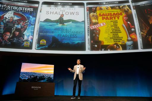 Sony CEO Kazuo Hirai introduces the Bravia A1E OLED TV during a news conference at CES International Wednesday, Jan. 4, 2017, in Las Vegas. (AP Photo/Jae C. Hong)