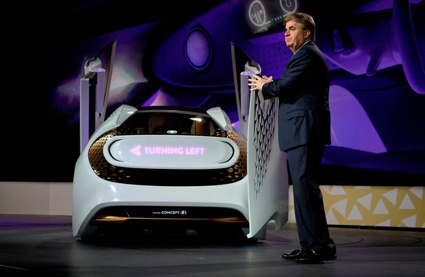 Bob Carter, Senior Vice President of automotive operations at Toyota, unveils the new Toyota Concept-i concept car, designed to learn about its driver, during the Toyota press conference at CES in Las Vegas, January 4, 2017. REUTERS/Rick Wilking