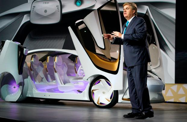 Bob Carter, senior vice president of automotive operations at Toyota unveils the new Toyota Concept-i concept car, designed to learn about its driver is unveiled during the Toyota press conference at CES in Las Vegas, January 4, 2017. REUTERS/Rick Wilking