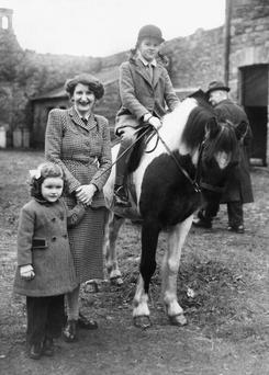 Molly with her daughters Virginia and Sally (on Bramble) in the yard at Belleville