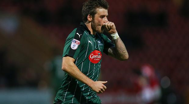 CREWE, ENGLAND - NOVEMBER 12: Graham Carey of Plymouth Argyle celebrates after scoring a goal to make it 1-2 during the Sky Bet League Two match between Crewe Alexandra v Plymouth Argyle at The Alexandra Stadium on November 12, 2016 in Crewe, England. (Photo by Robbie Jay Barratt - AMA/Getty Images)