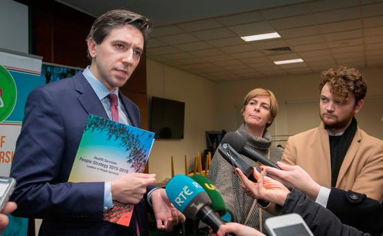 Health Minister Simon Harris talks to reporters following a meeting before Christmas with the HSE about the implementation of the Winter Initiative. Photo: Gareth Chaney/Collins