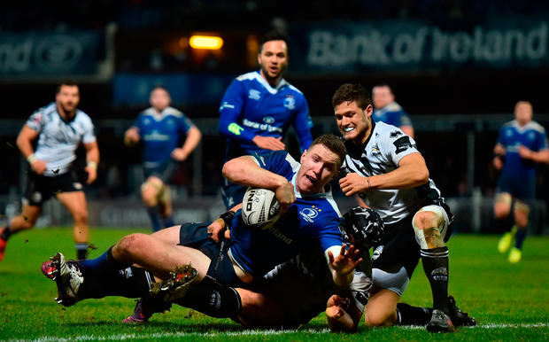 Rory O'Loughlin of Leinster on his way to scoring his third try. Photo: Sportsfile