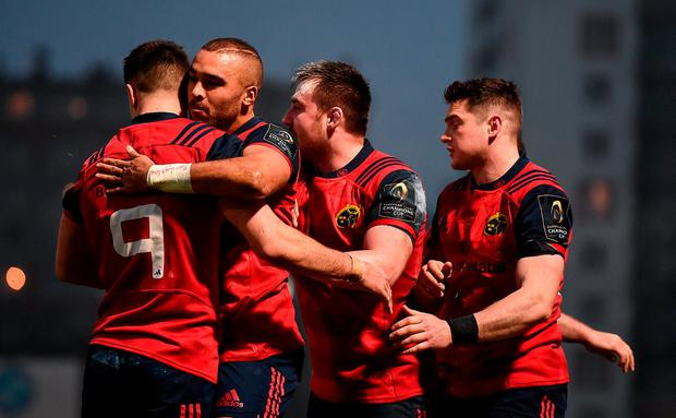 Simon Zebo is congratulated by his Munster team-mates, including Conor Murray, 9, after scoring his side's first try during the European Rugby Champions Cup Pool 1 Round 1 match between Racing 92 and Munster at the Stade Yves-Du-Manoir in Paris, France. Photo by Stephen McCarthy/Sportsfile