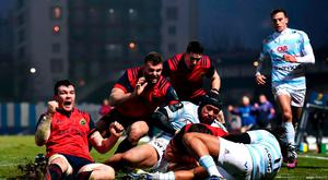 Munster captain Peter O'Mahony celebrates as team-mate CJ Stander goes over for his side's second try during the European Rugby Champions Cup Pool 1 Round 1 match between Racing 92 and Munster at the Stade Yves-Du-Manoir in Paris, France. Photo by Stephen McCarthy/Sportsfile
