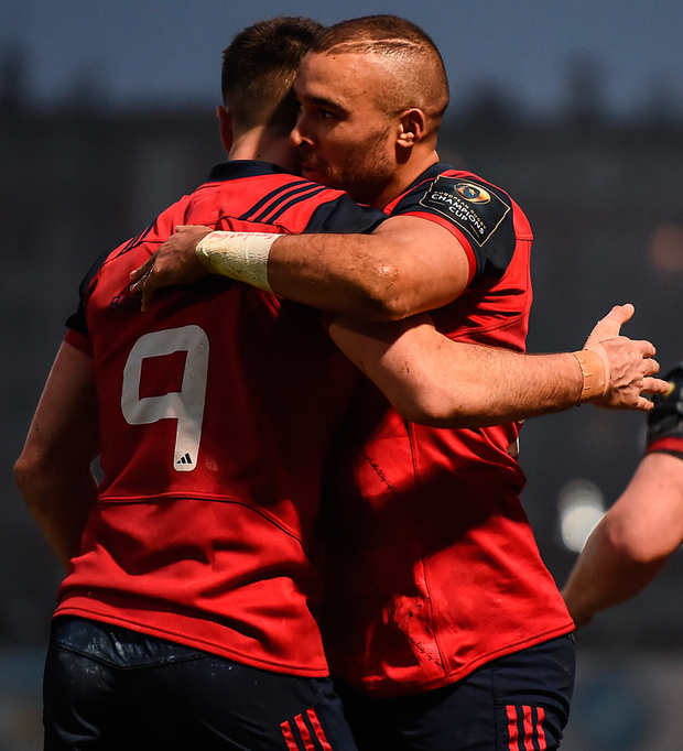 Simon Zebo is congratulated by his Munster team-mate Conor Murray, 9, after scoring his side's first try at the Stade Yves-Du-Manoir in Paris. Photo: Stephen McCarthy/Sportsfile