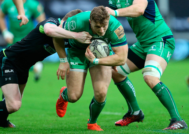 Connacht's Peter Robb is tackled by Olly Cracknell of Ospreys. Photo: Chris Fairweather/Sportsifle