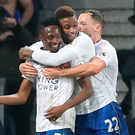 Leicester's Ahmed Musa is congratulated by team-mates. Photo: PA
